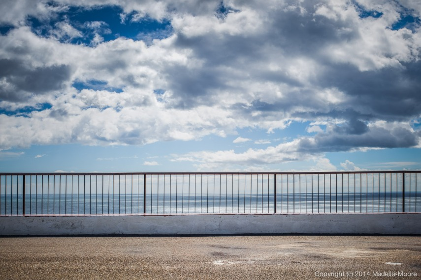 Railing between land and sea
