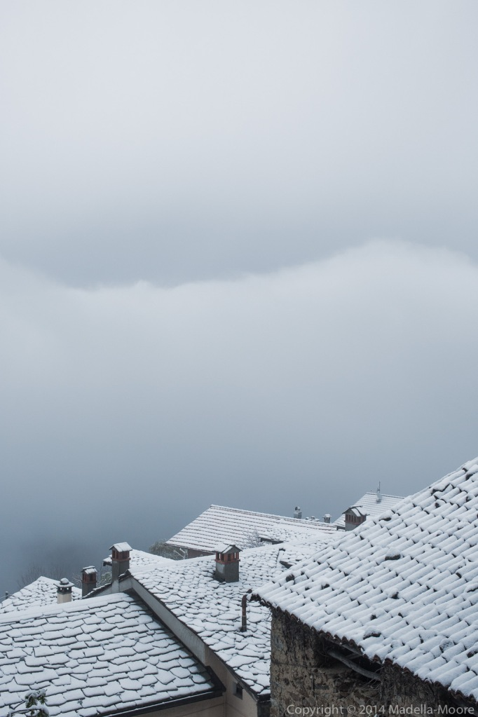 Snow covered rooftops, Sanico. 50mm f9.0.