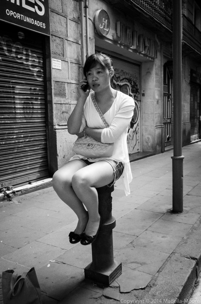 Girl Sitting on a Pole, Barcelona Street Photograph