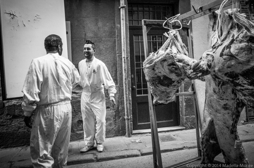 Two men joking while delivering meat to a butcher stall, Barcelona