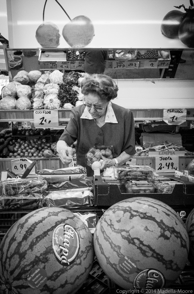 Lady shopping for fruit and vegetables.