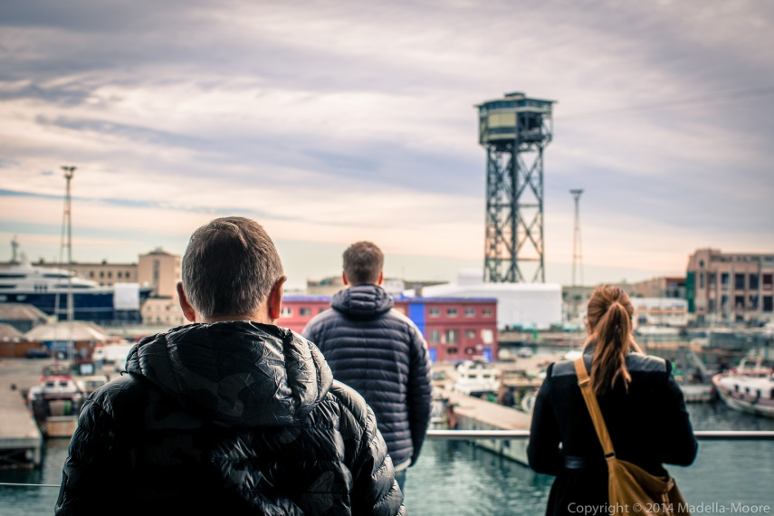 Three tourists looking out to a surreal scene at Mare Magnum, Port Vell, Barcelona