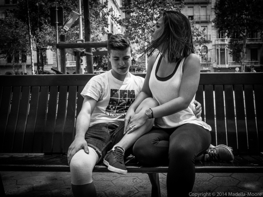Boy with plaster cast and excited woman, Barcelona Street Photography