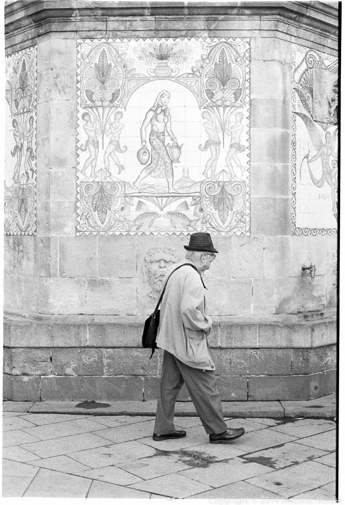 Old Man walking in front of Tiles, Barcelona