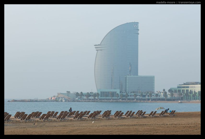 Putting out deck-chairs on the beach in front of the W-Hotel, Barcelona.