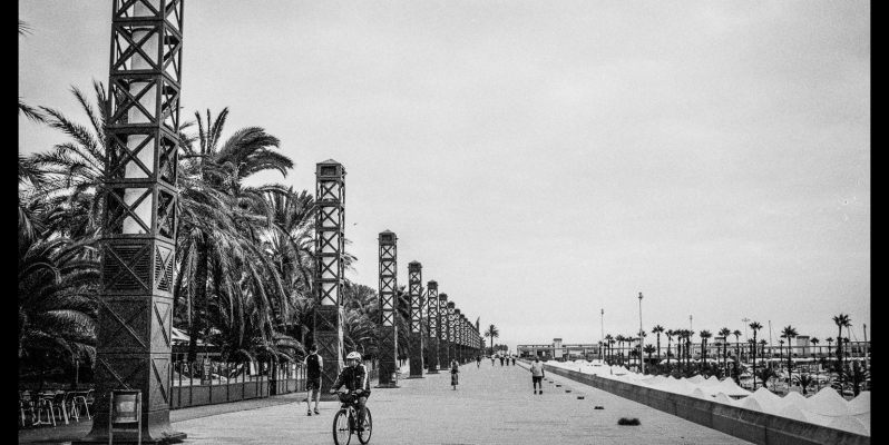 The promenade alongside the marina at Port Olimpic, Barcelona. Leica M7, Zeiss ZM 2/35 Biogon with Ilford HP5+.