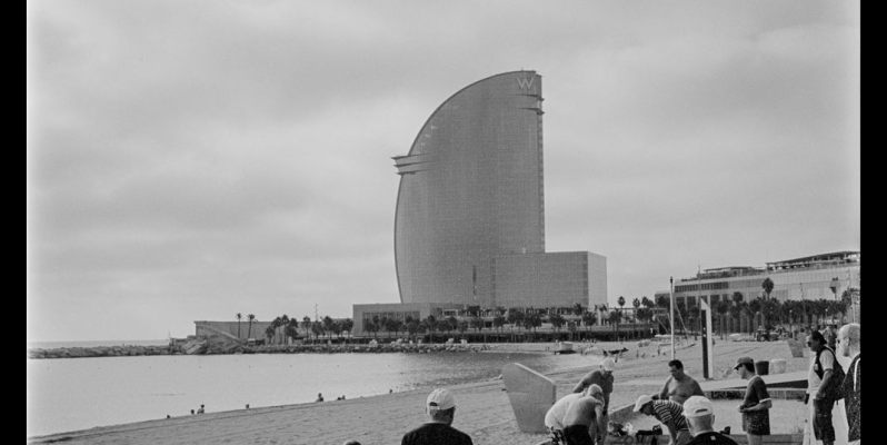 Game playing, Playa de Sant Sebastian, Barceloneta, Barcelona.