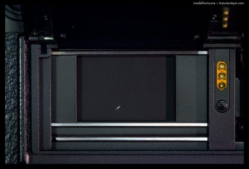 Leica shutter curtain with burn hole.
