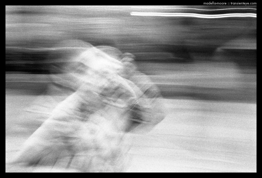 Long exposure, black and white abstract street photograph.