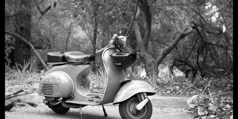 Black and white film photograph of an old scooter, San Francisco.