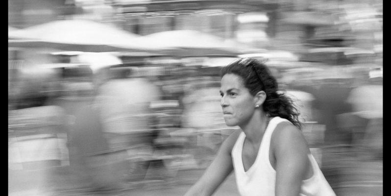 Blur - fast cyclist on Las Ramblas, Barcelona - Black and White Film Photograph