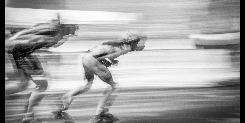 Racing Rollerskaters at the Fiesta Mayor en el Raval, Rambla del Raval, Barcelona – Motion Blurred Film Photography