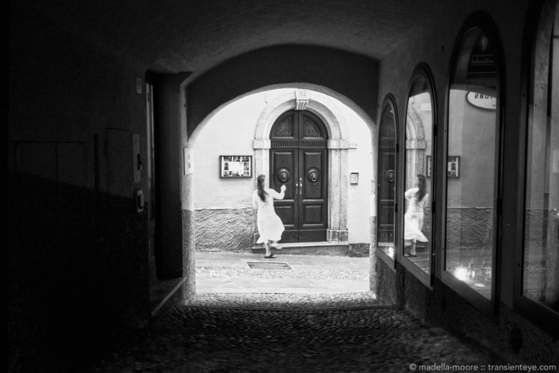 Girl in Doorway, Bellagio, Italy. Leica M7 with Zeiss ZM 1.5/50 and Ilford Delta 100 film.