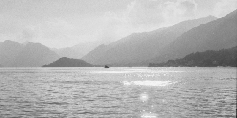 Light reflecting on water, Lago di Como, Italy. Leica M7, Zieiss C-Sonnar ZM 1.5/50, Ilford Delta 100