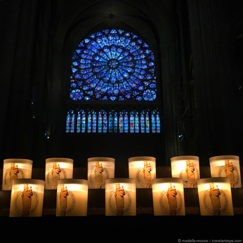 Candles and windows at Notre Dame.