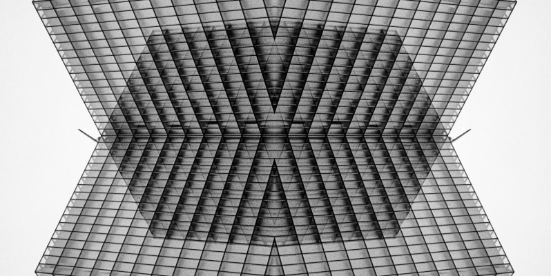 Abstracted skyscraper (Bibliothèque nationale de France) architecture, Paris. Photoshop composite of a black-and-white film image.