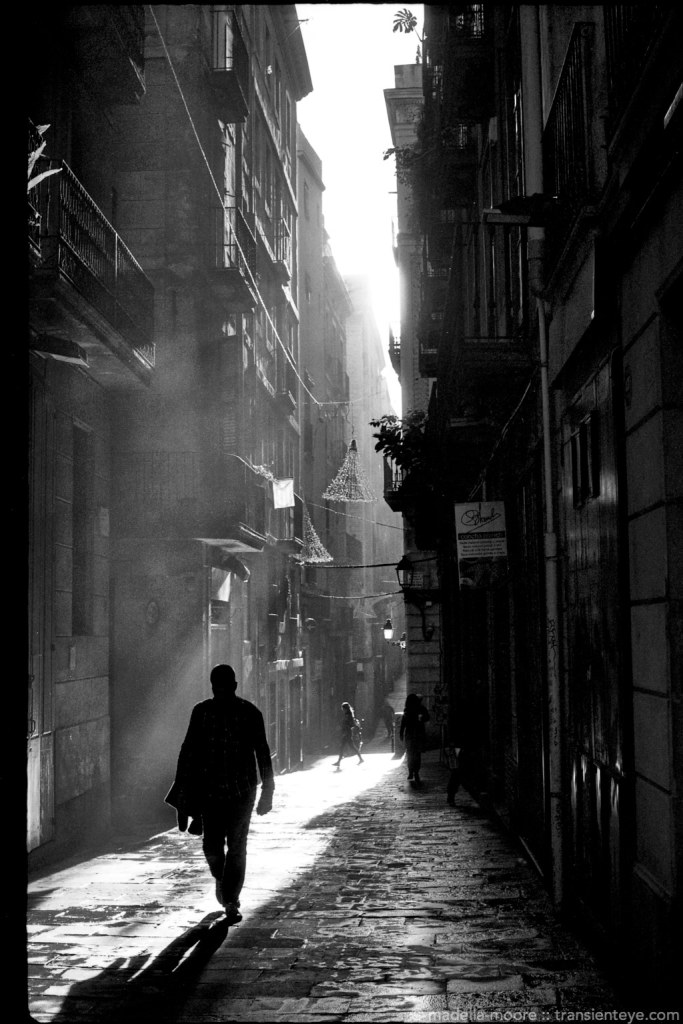 Noir-style street photograph in Barcelona. Shot using a FED 5b and Delta 100 film.