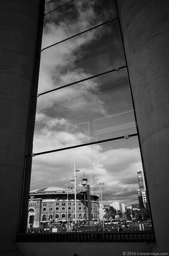 Las Arenas, seen in reflection from Fira on the Monjuic. Ricoh GR B&W.