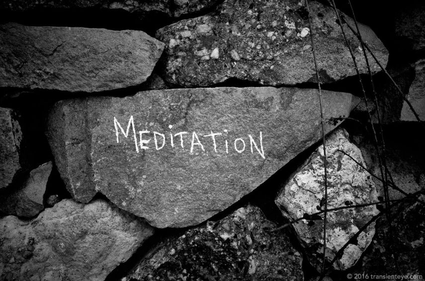 Meditation: Inscription on a stone wall, Barcelona.