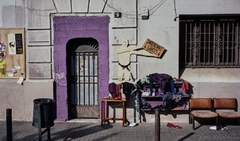 Clothing exchange outside of a squatted building, El Raval, Barcelona.