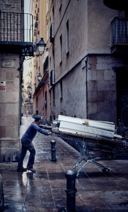 Metal collecting on a shopping trolly, Barcelona.