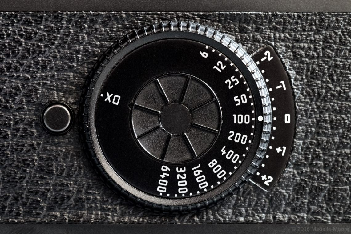 The ISO speed and exposure compensation dial.