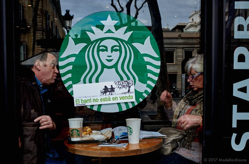 Two tourists in a protest-stickered Starbucks, Ocupació Popular de les Rambles, Barcelona, January 2017