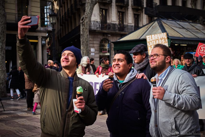 Tourists taking a selfie in front of a protest, Ocupació Popular de les Rambles, Barcelona, January 2017