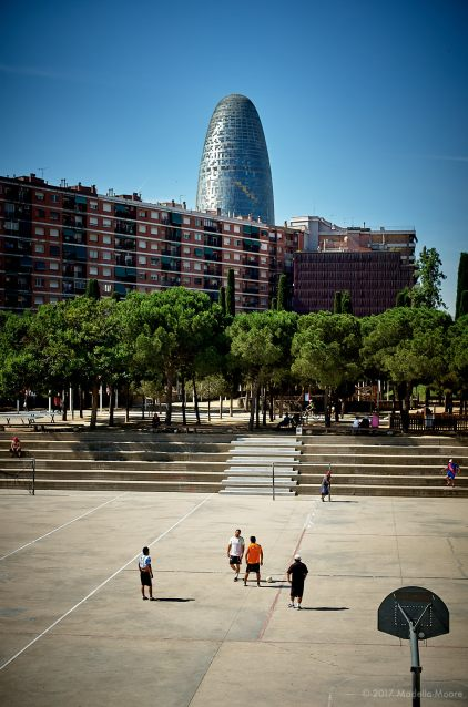 Torre Glòries, seen from the Parc del Clot, Barcelona. If everyone seems to be playing football around the tower, that might be because the tower's default colours are those of FC Barcelona...