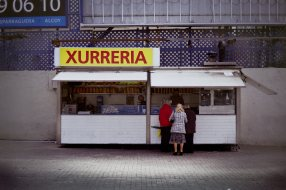 A street Xurreria in Barcelona. Churros are a kind of extrusion moulded deep-fried donut, often eat after dipping in hot chocolate.