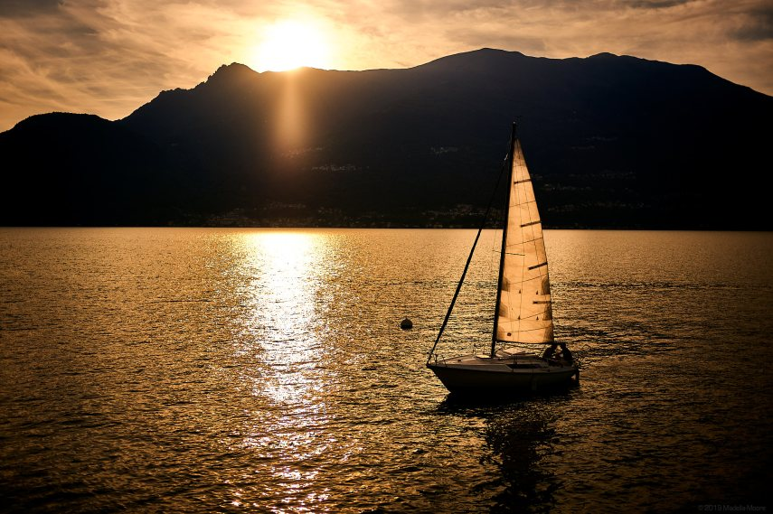 Sunset and yacht on Lago di Como, Italy.